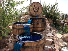 Reclaimed Oak Whiskey Barrels Repurposed as Waterfall