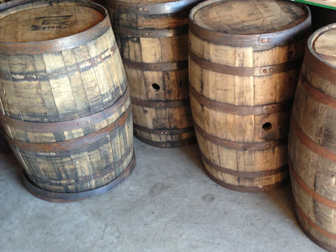 Multiple reclaimed whiskey barrels. Material Resourcers repurposes materials from industrial & manufacturing companies. Bring us your waste, excess, non-recyclable, by-product, remnant, blemished, cancelled, and expired materials.