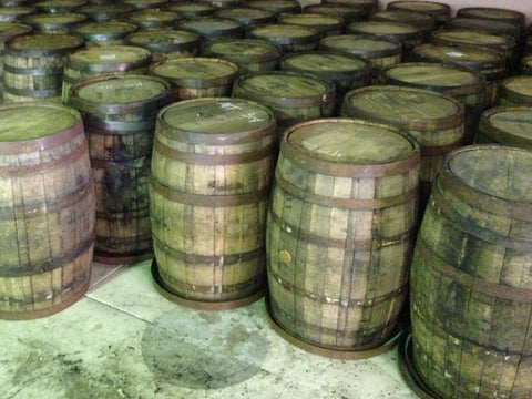 View of dozens of reclaimed oak whiskey barrels. Material Resourcers repurposes materials from industrial & manufacturing companies. Bring us your waste, excess, non-recyclable, by-product, remnant, blemished, cancelled, and expired materials.