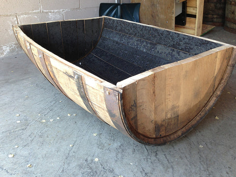 Side view of cradle-cut whiskey barrel. Material Resourcers repurposes materials from industrial & manufacturing companies. Bring us your waste, excess, non-recyclable, by-product, remnant, blemished, cancelled, and expired materials.