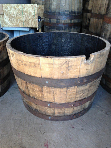 Oak whiskey barrel cut in half to make a planter. Material Resourcers repurposes materials from industrial & manufacturing companies. Bring us your waste, excess, non-recyclable, by-product, remnant, blemished, cancelled, and expired materials.