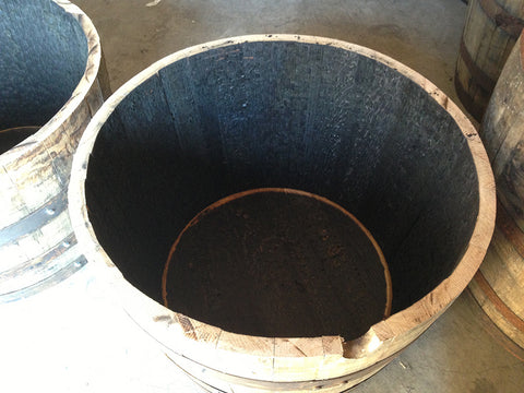Top view of whiskey barrel planter. Material Resourcers repurposes materials from industrial & manufacturing companies. Bring us your waste, excess, non-recyclable, by-product, remnant, blemished, cancelled, and expired materials.