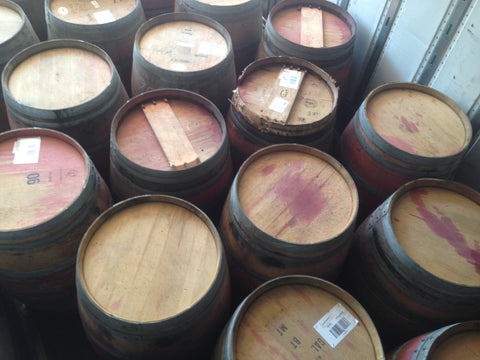 Reclaimed wine barrels loaded on truck. Material Resourcers repurposes materials from industrial & manufacturing companies. Bring us your waste, excess, non-recyclable, by-product, remnant, blemished, cancelled, and expired materials.
