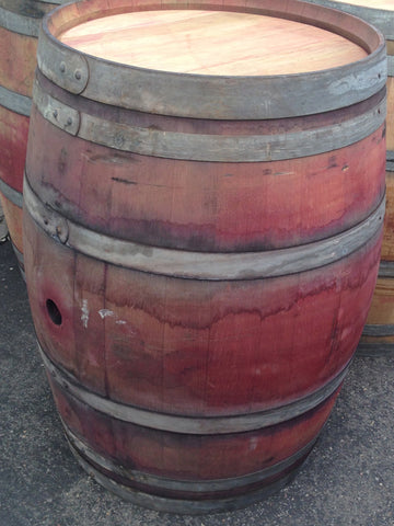 Single reclaimed wine barrel. Material Resourcers repurposes materials from industrial & manufacturing companies. Bring us your waste, excess, non-recyclable, by-product, remnant, blemished, cancelled, and expired materials.