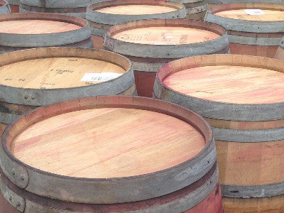 Another view of reclaimed wine barrels. Material Resourcers repurposes materials from industrial & manufacturing companies. Bring us your waste, excess, non-recyclable, by-product, remnant, blemished, cancelled, and expired materials.