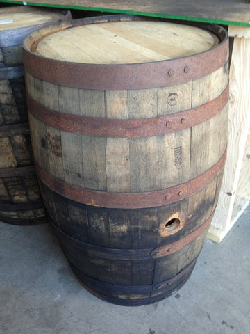 Single reclaimed whiskey barrel. Material Resourcers repurposes materials from industrial & manufacturing companies. Bring us your waste, excess, non-recyclable, by-product, remnant, blemished, cancelled, and expired materials.
