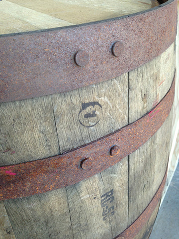 Close up of upper steel bands on barrel. Material Resourcers repurposes materials from industrial & manufacturing companies. Bring us your waste, excess, non-recyclable, by-product, remnant, blemished, cancelled, and expired materials.