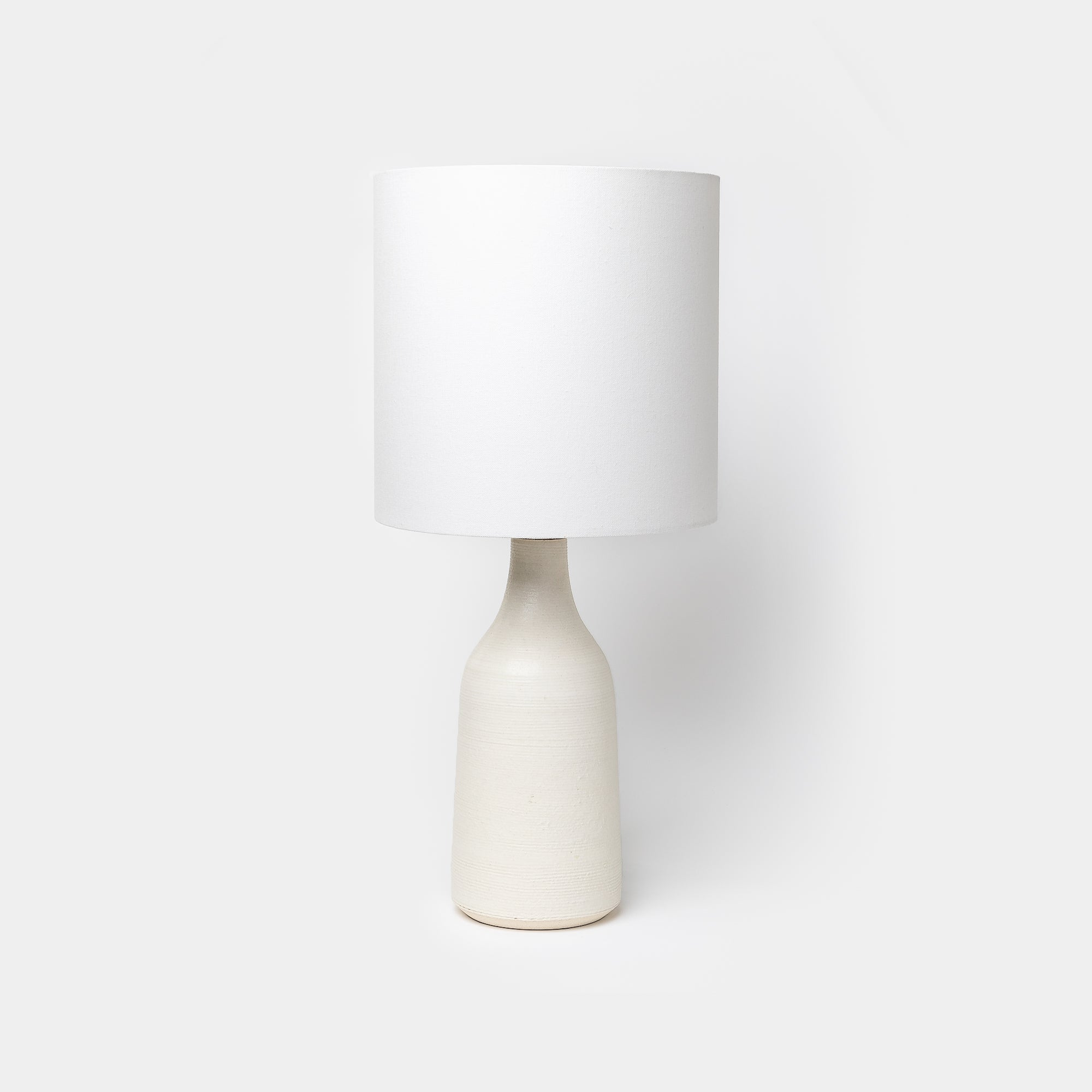 Ivory Ribbed Bottle Lamp by Victoria Morris