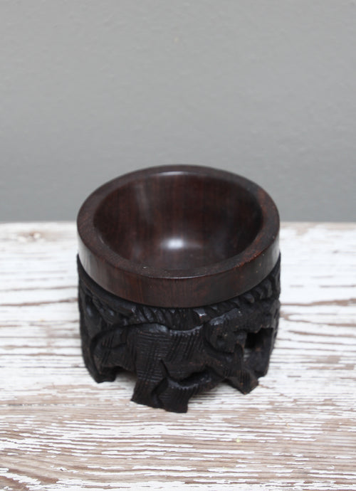Ebony carved wooden egg stand
