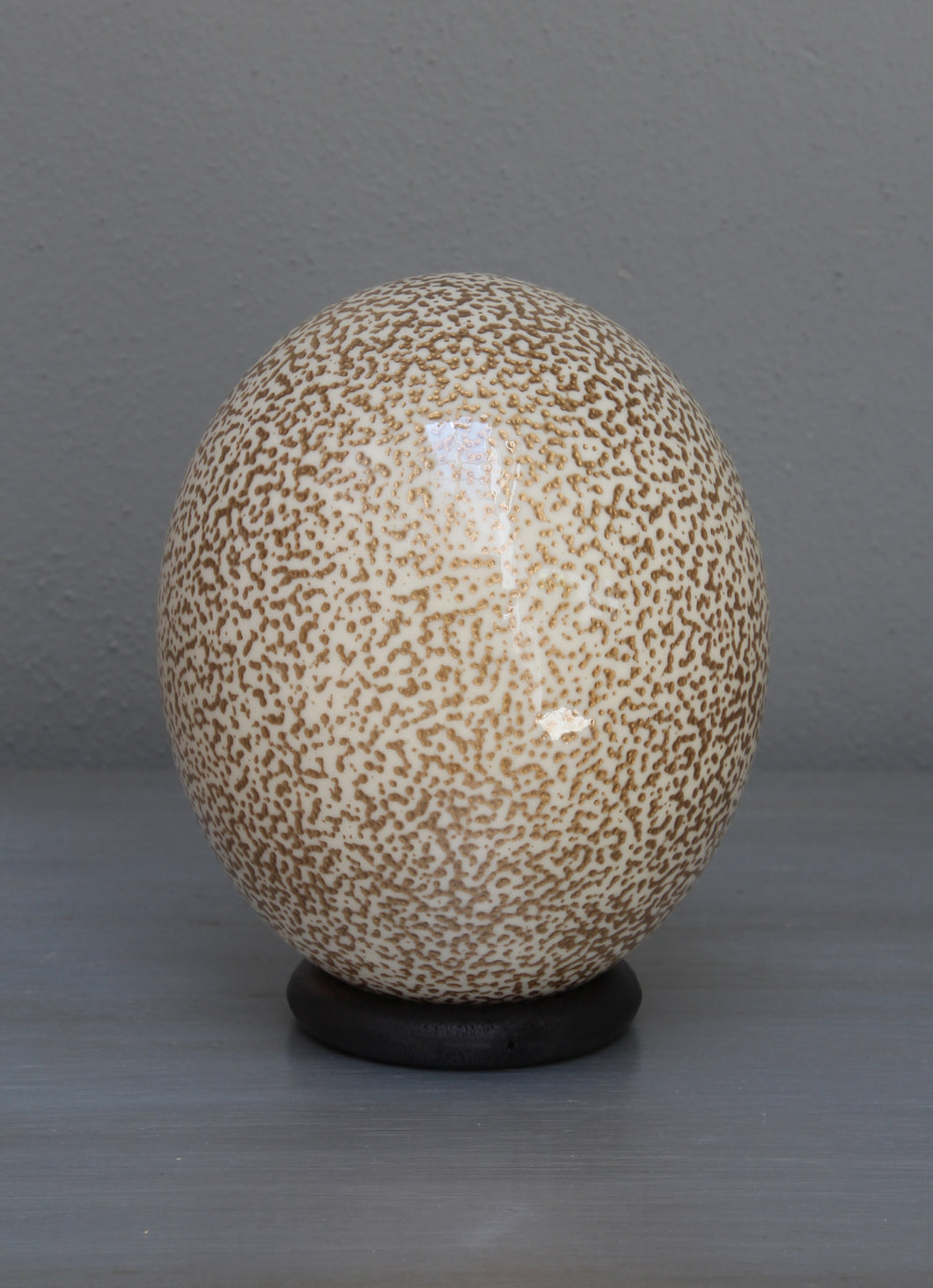 Speckled cream and gold ostrich egg