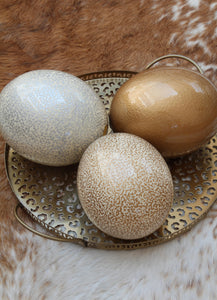 Speckled cream and silver ostrich egg
