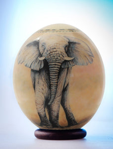 Decoupage elephant and map ostrich egg
