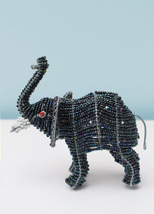 Beaded elephant with trunk up