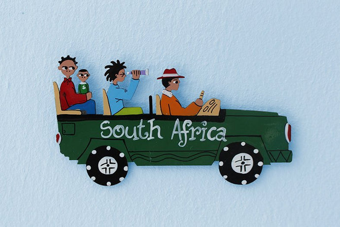 Hand-painted metal Land Rover magnet