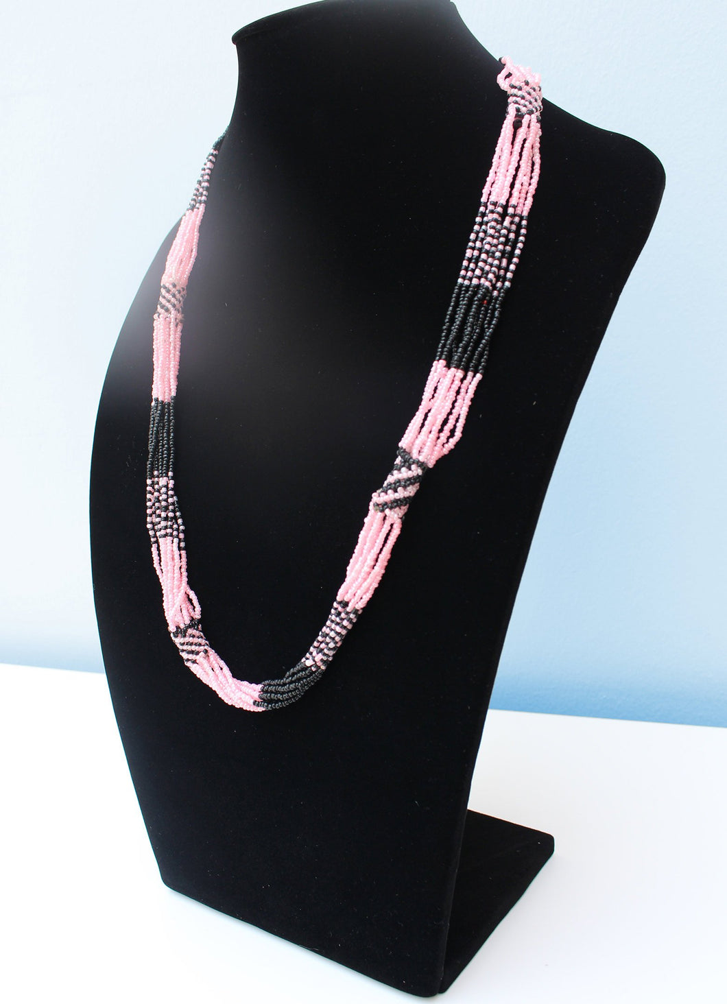 Multi-stringed Maasai pink and black beaded necklace