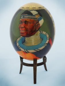 Decoupage African venda man and Africa map ostrich egg