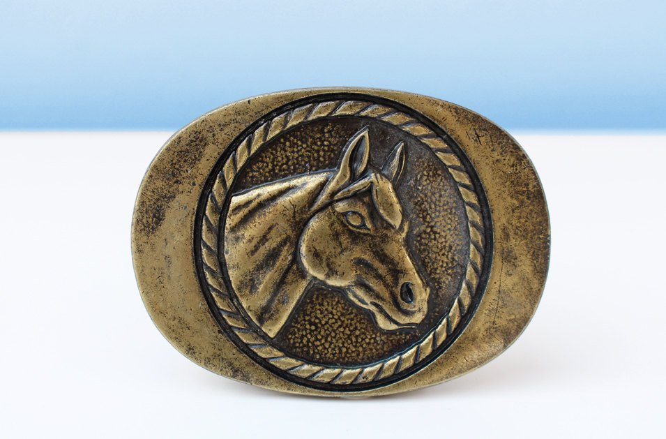 Brass horse belt buckle