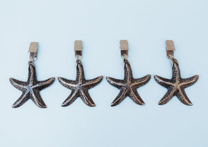 Antique nickel starfish tablecloth weights