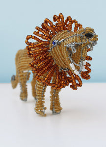 Beaded African lion on the hunt