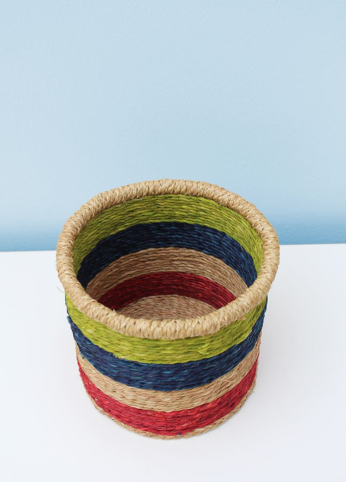 Multicoloured grass-woven African basket