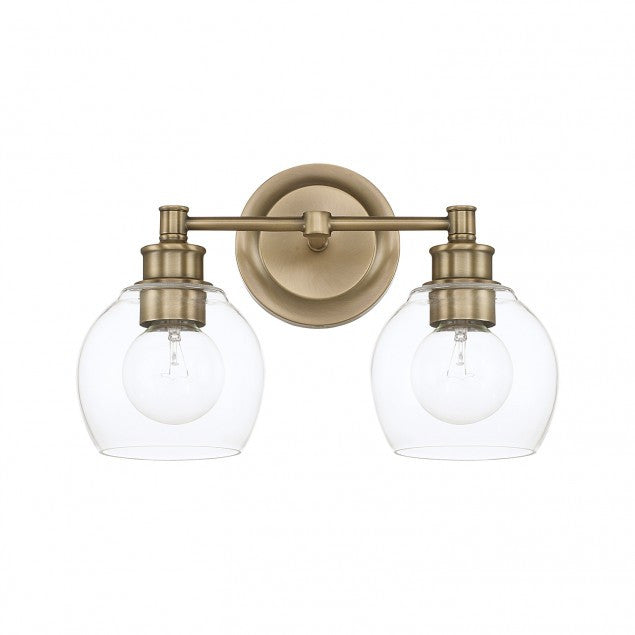 Capital Lighting Mid-Century 2-Light Vanity Light in Aged Brass with clear rounded glass shades by  121121AD-426