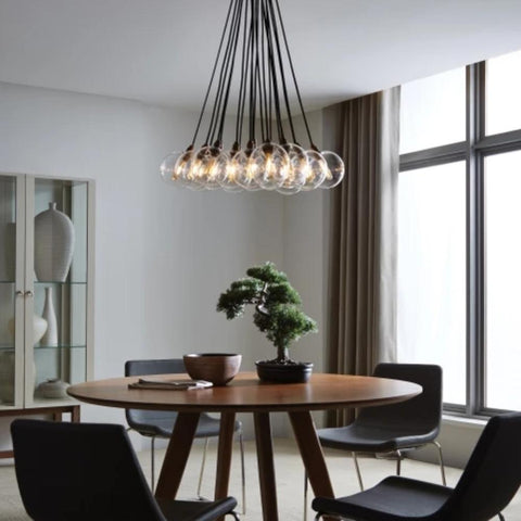 Lifestyle Shot of Gambit Chandelier, 19-Light Chandelier, Aged Brass