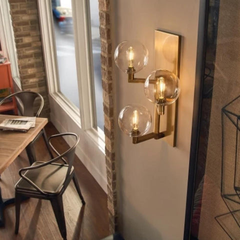 Lifestyle Shot of Gambit Sconce, 3-Light Wall Sconce, Aged Brass