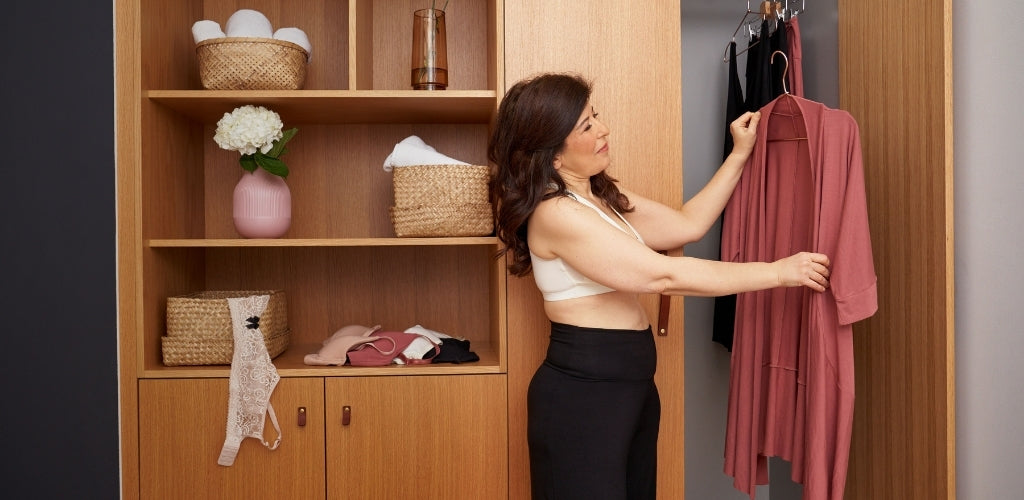 Woman looking at clothing in closet