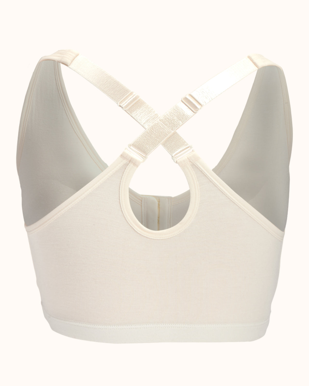 Ivory, pocketed front closure wireless bra with soft modal material and convertible & adjustable straps.