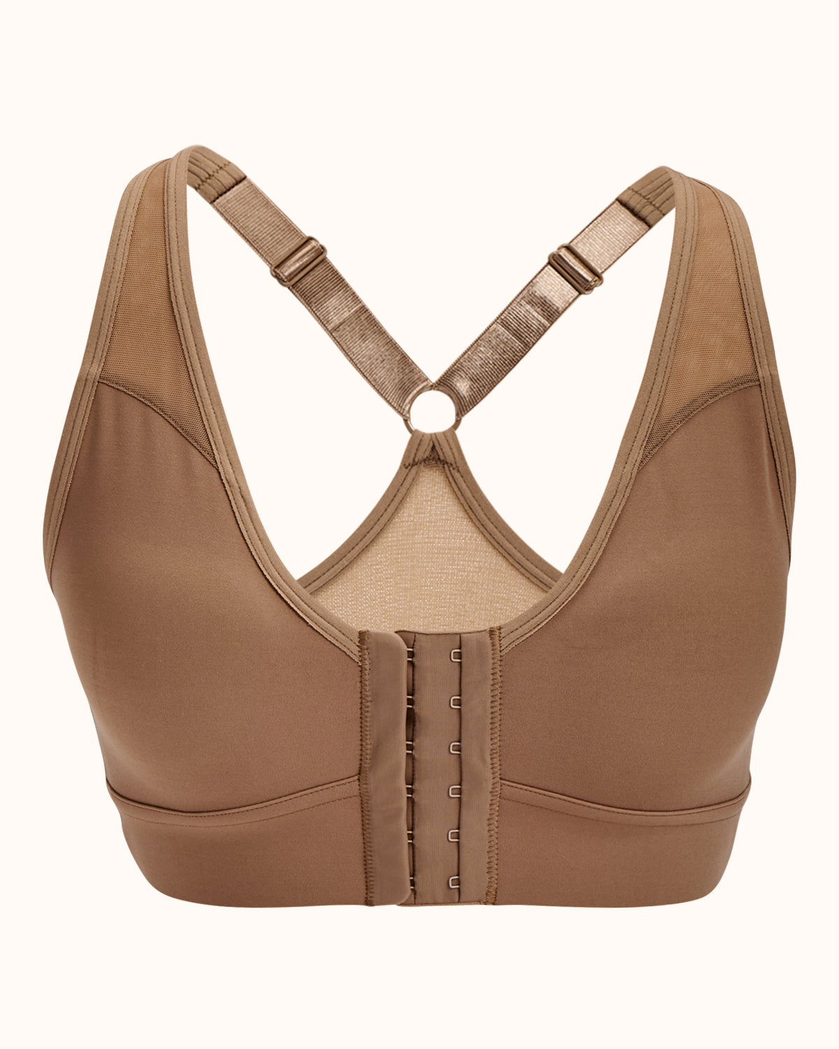 Sand, pocketed front closure sports bra with adjustable straps, mesh paneling on cross back, soft material and wireless cups.