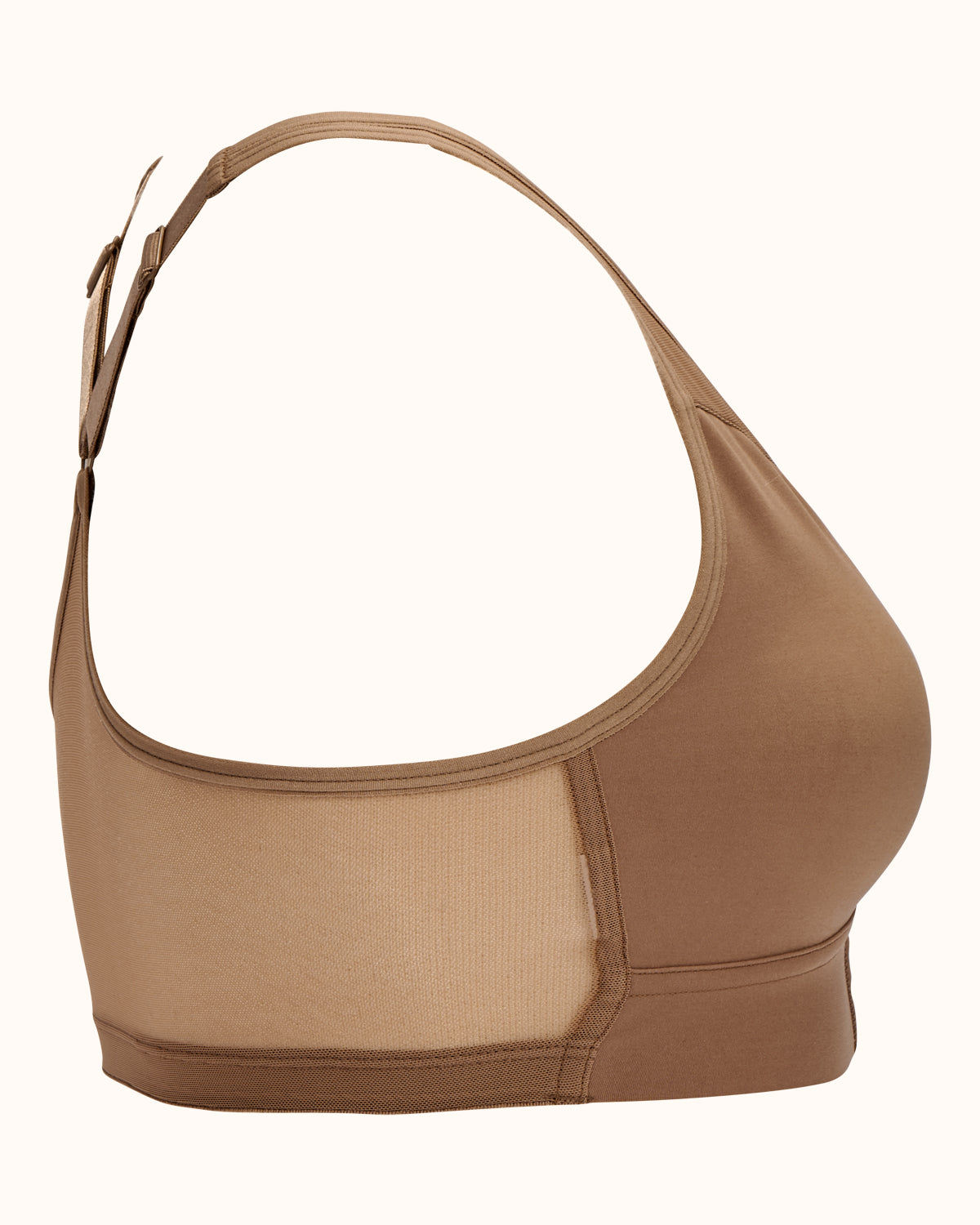 Sand, pocketed front closure sports bra with soft wireless cups, adjustable straps and mesh paneling on cross back.