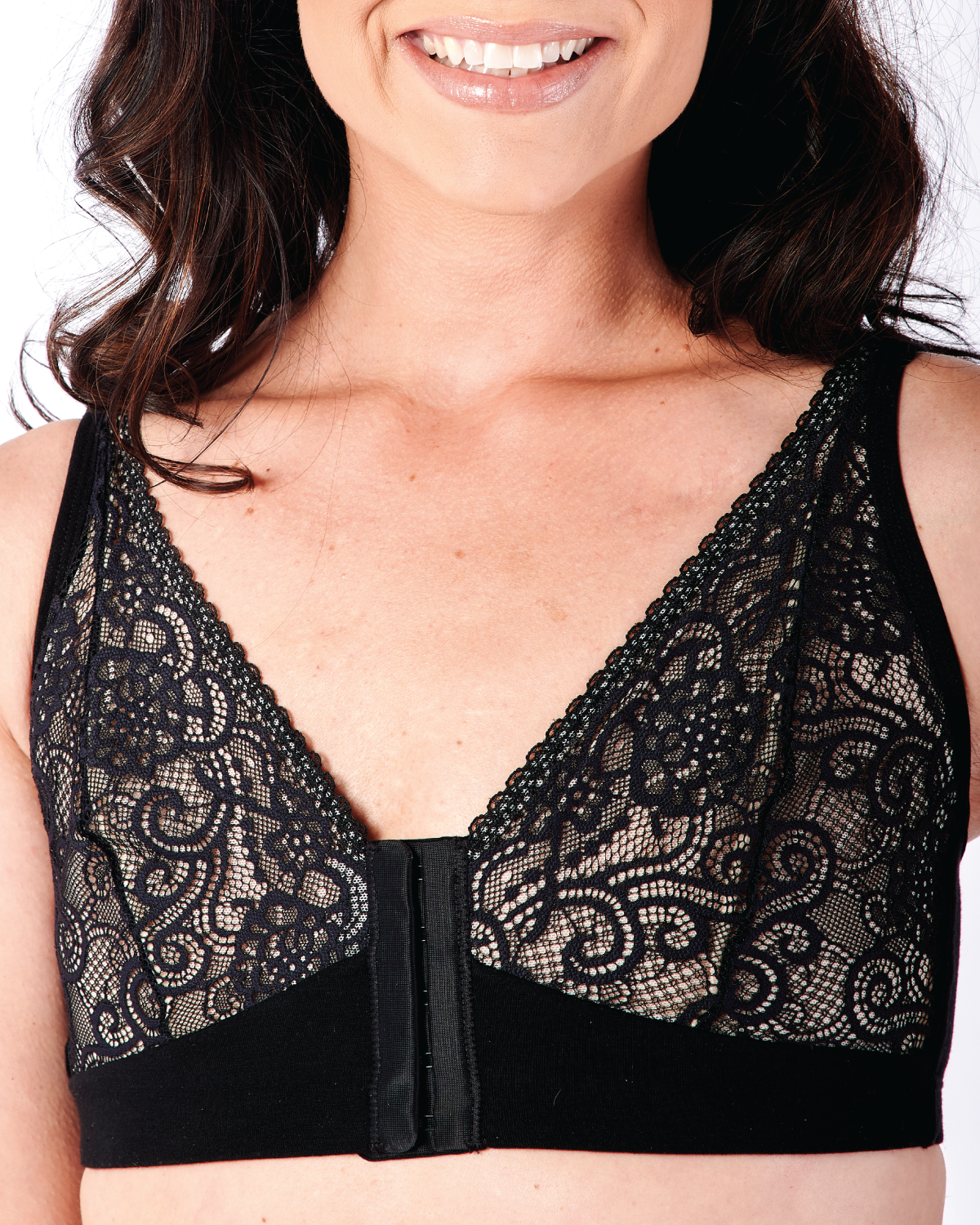 Black, pocketed front closure lace bra made with soft modal, dual adjustable back straps and underwire free cups on a flat chested model.