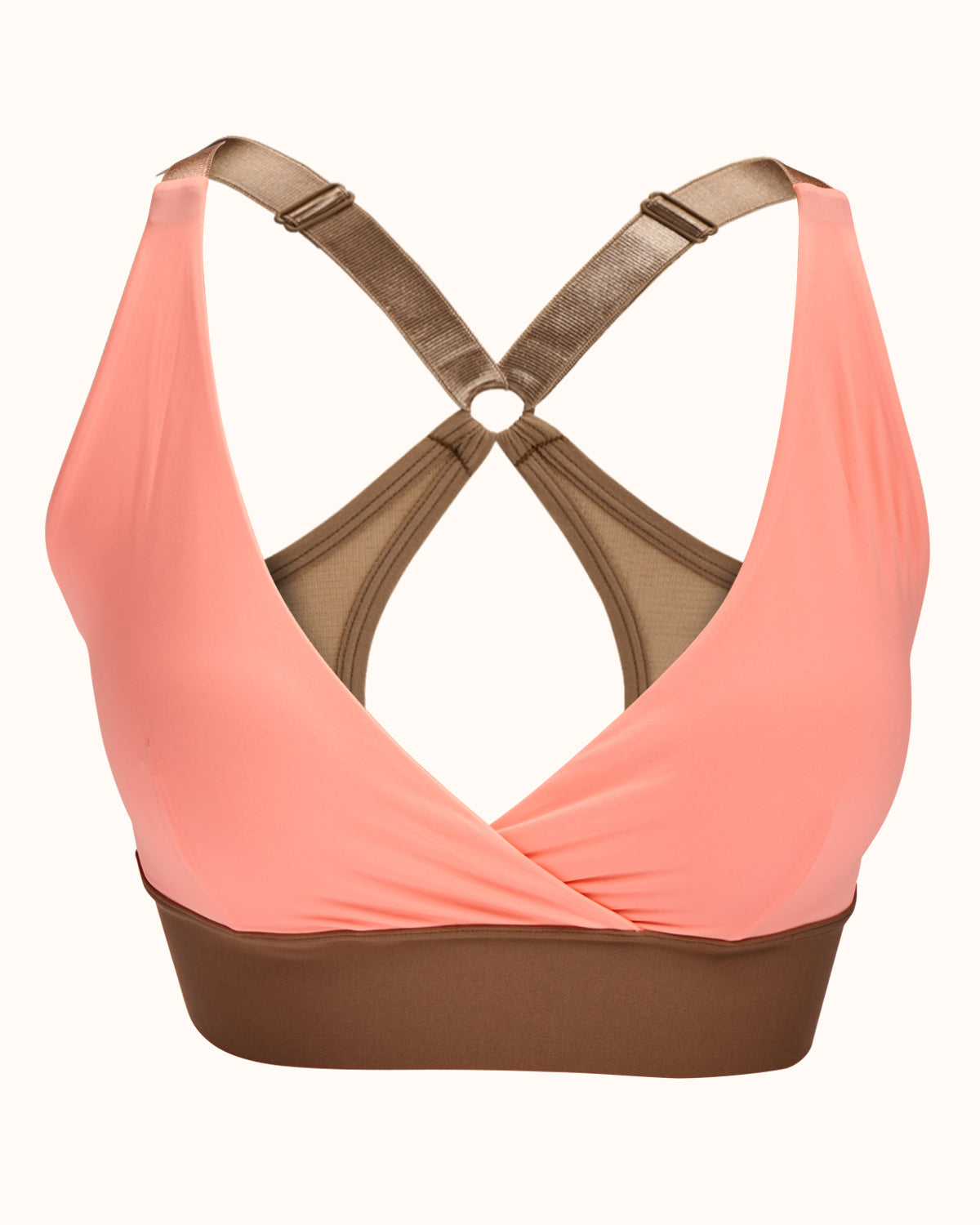 Coral, pocketed wrap sports bra with racerback, back closure and adjustable strap.