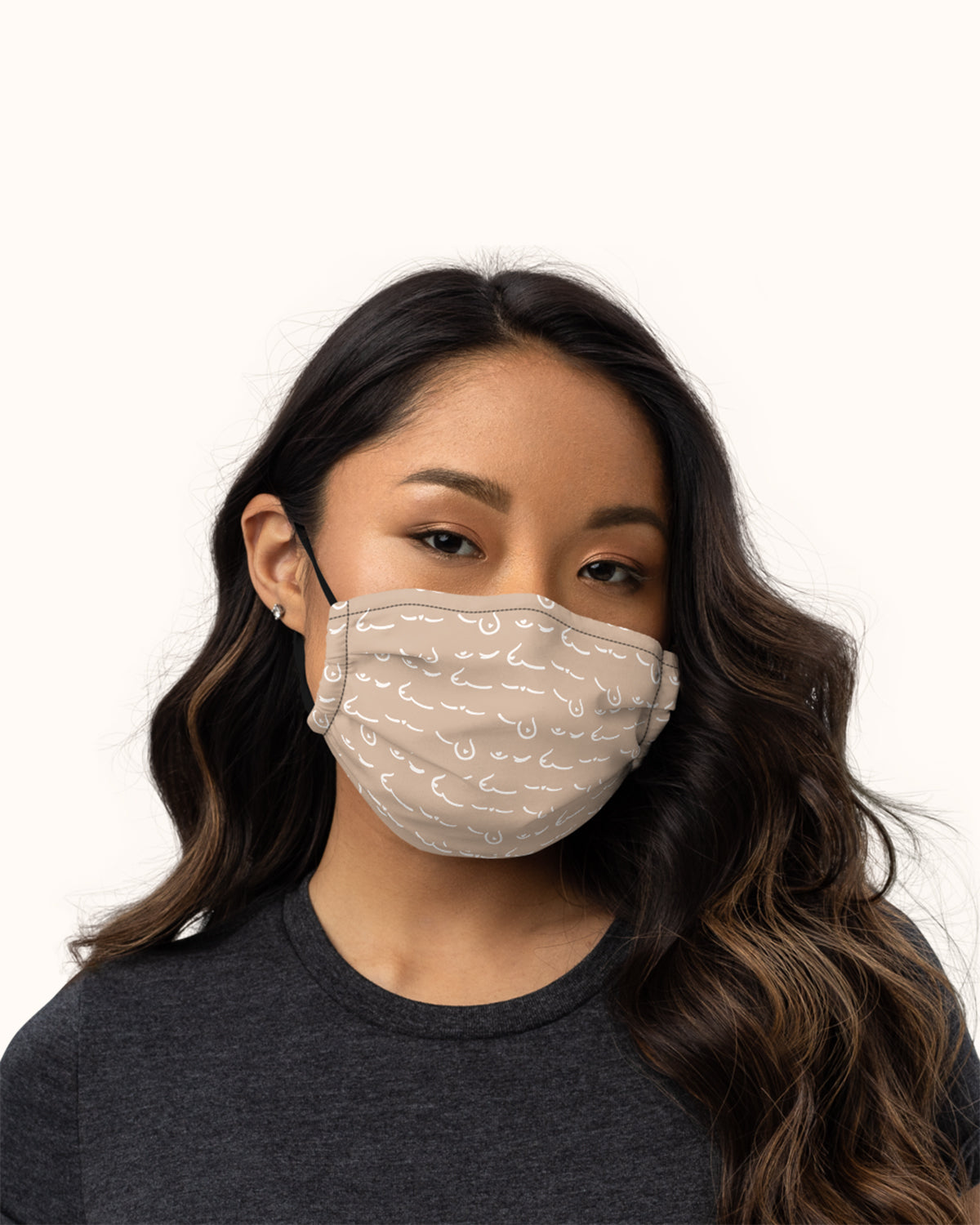 Sand, F(oo)B® printed facemask that has an adjustable nose wire and elastic bands.
