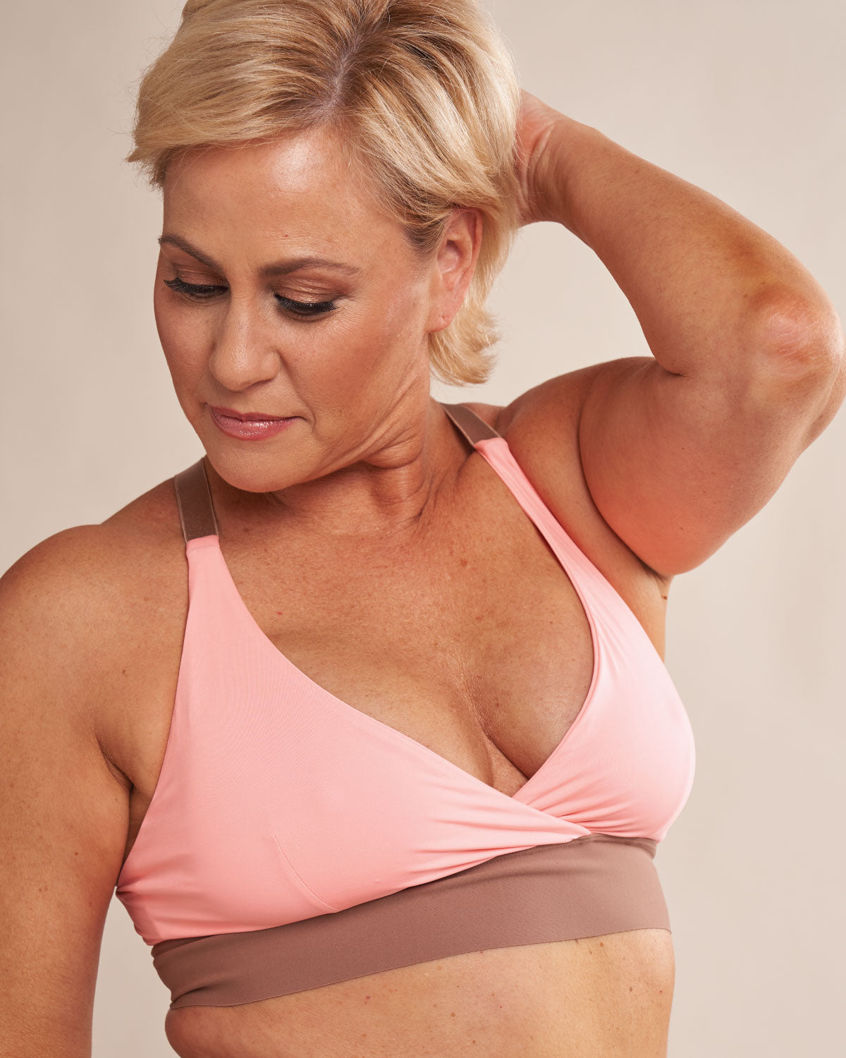 Black, pocketed wrap sports bra with racerback, back closure and adjustable straps.