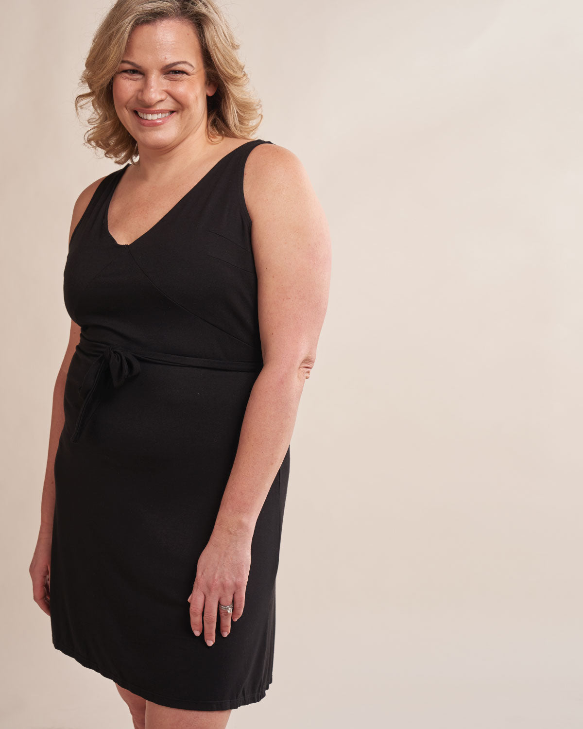 Black, tank v neck wrap dress with a tie waist, smooth mesh back panels & an attachable drain belt.