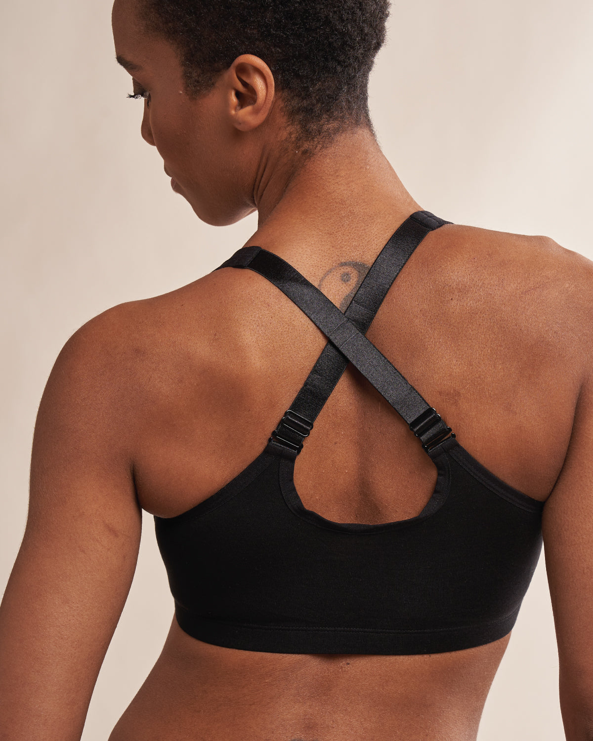 Black, pocketed front closure wireless bra with soft modal material and convertible & adjustable straps.