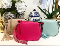 Whipstitch Saddlebag Crossbody Purses in hot pink, light blue, and light beige