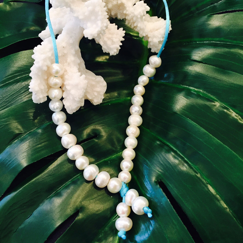 Teramasu Pearl Necklace on Turquoise Satin