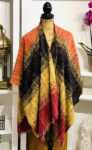 Striking Multicolored Cape with Fringe Hem