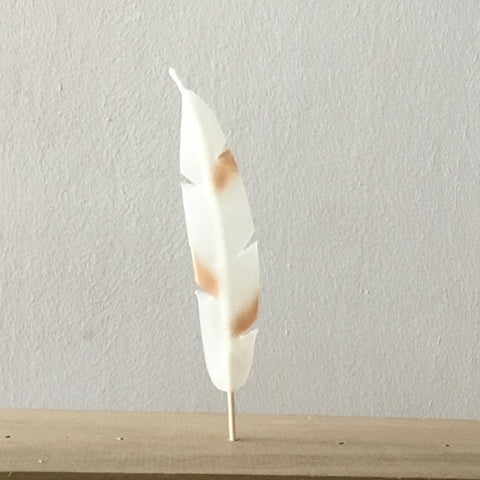 bronze and white feather candle