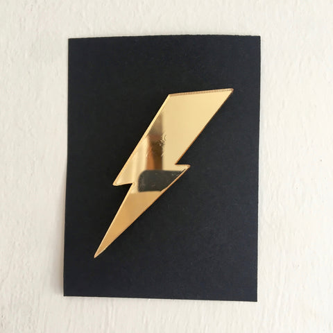 gold reflective lightning bolt badge