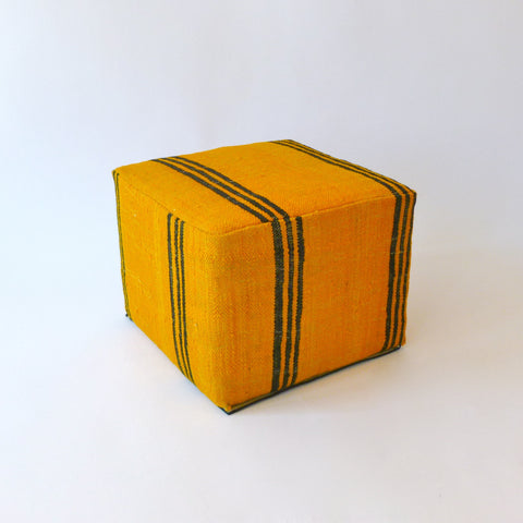 yellow and black moroccan pouf