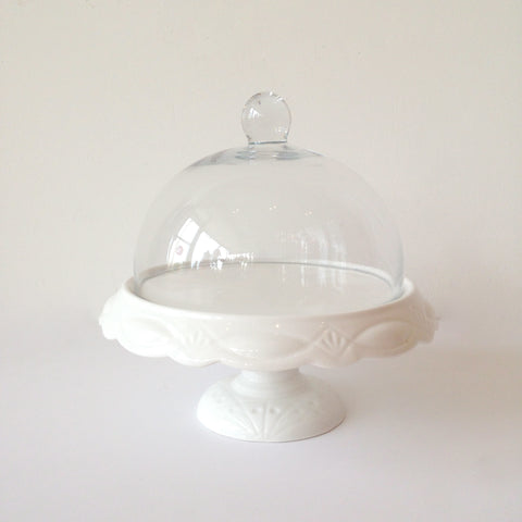small white scalloped cake stand