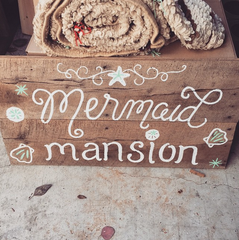 mermaid mansion sign