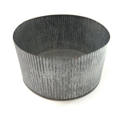 large wide wavy tin container