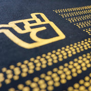 detail of detail of broken riders stateside black organic cotton tee