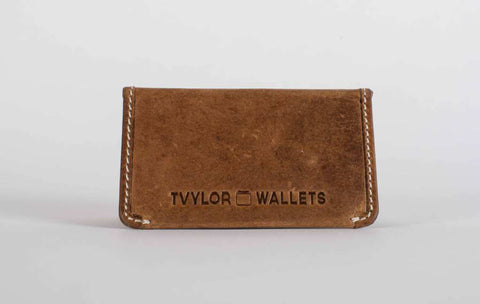 Tvylor with front embossing and white stitching