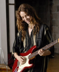 Saffron Burrows wears Catherine Angiel jewelry in the movie, Guitar