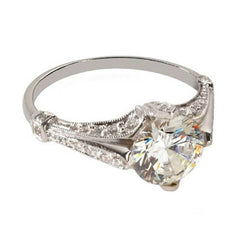 Antique style engagement ring with pave side diamonds